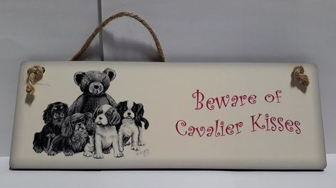 Beware of Cavalier Kisses Sign